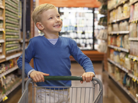 little and proud boy helping with grocery shopping, healthy lifestyle concept